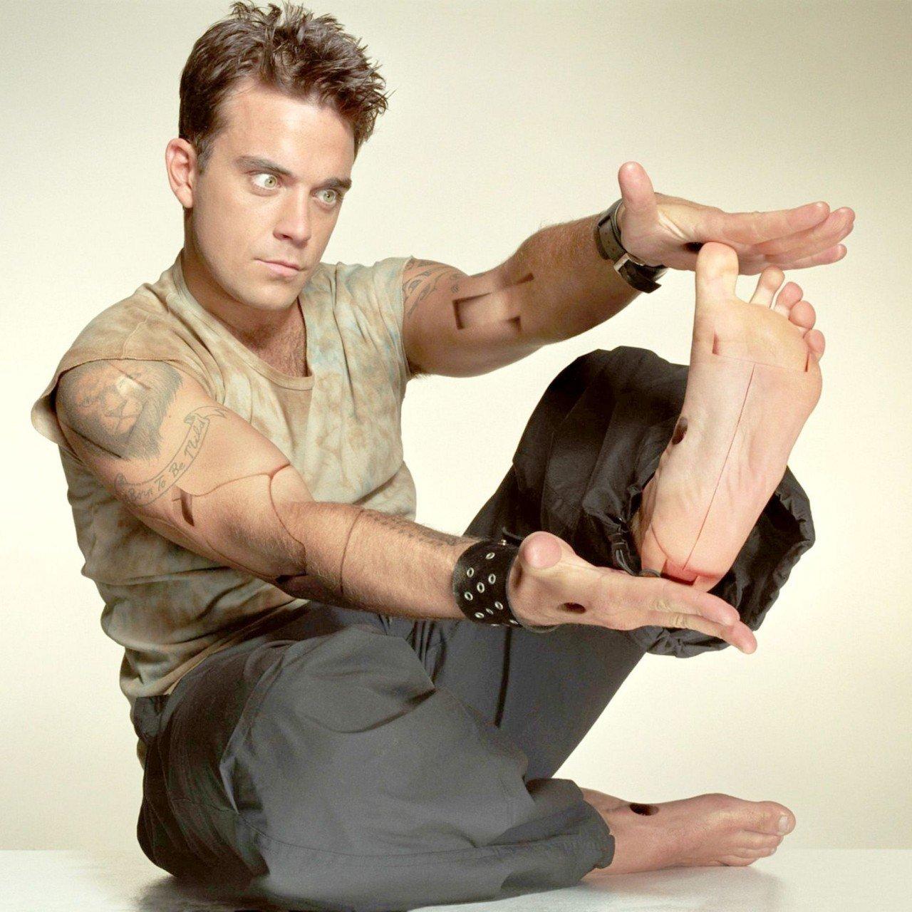 a80c436815a2 Robbie Williams è un tipico esempio di uomo a mattone!